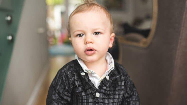 A toddler putting on the Petit Pli. Image via Petit Pli
