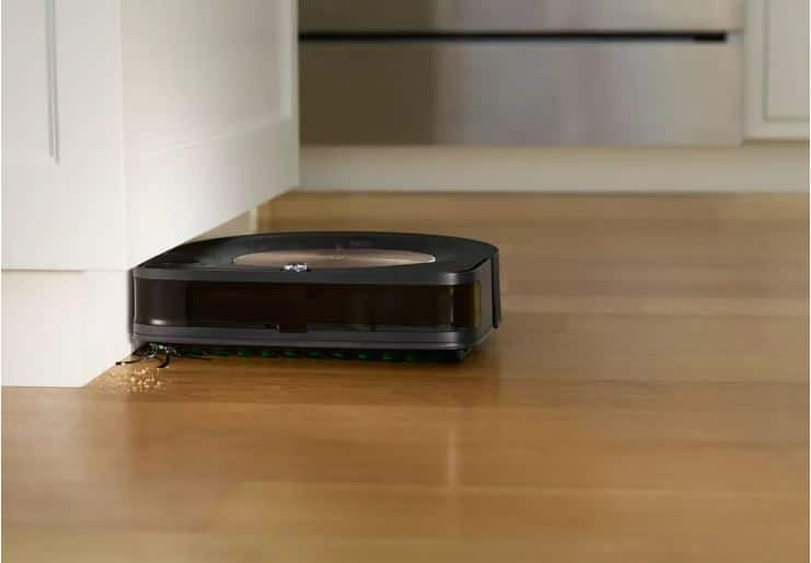 The Roomba s9+ cleaning the edges with its angled brush. Image via iRobot