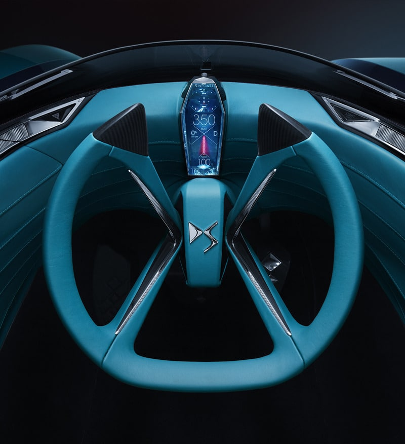 The steering wheel as seen from the driver's cockpit. Image via DS