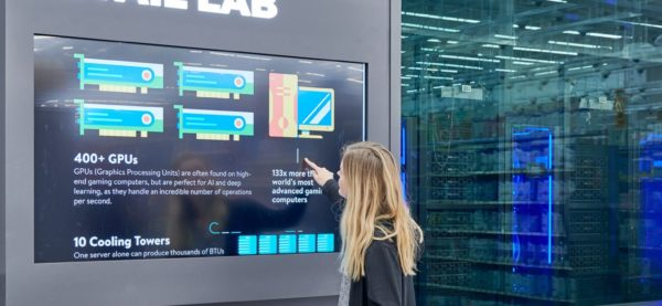 A lady looks at the technical specifications of the IRL system. Image via Walmart