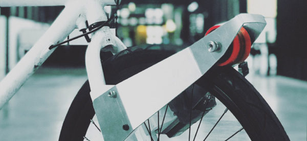The CLIP e-motor latches itself onto the tire to allow automated-assist cycling mode.