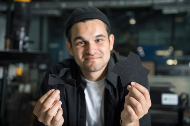 Yasin holding his design artworks. Image via James Dyson Award