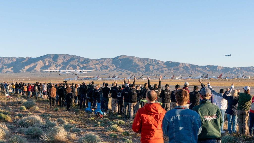 The crowd watches on as the Stratolaunch takes flight for the first time