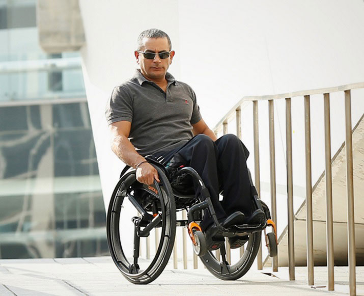 Gilad Wolf, the product designer tests out the Softwheel on his wheelchair. Image via NoCamel
