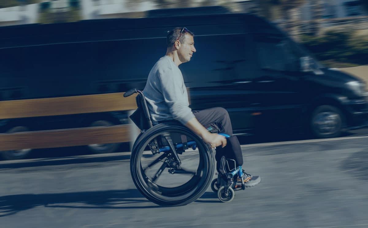 A wheelchair user travels uphill on Softwheel. Image via Softwheel Technology