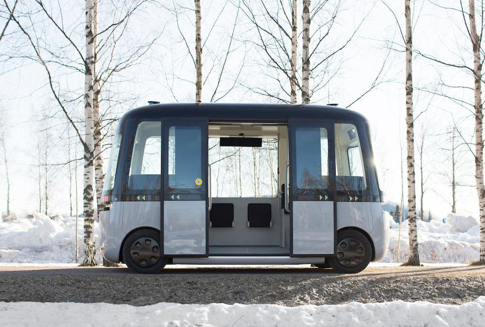 The autonomous bus sits on a snowy pathway.  Image via Muji
