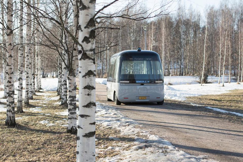 The shuttle bus tracks through the snowy forest of Finland. Image via Muji